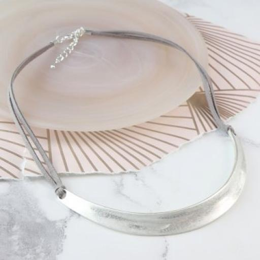 Peace Of Mind. Double strand grey cord necklace with a silver plated curve in a worn finish, fastened with a silver plat